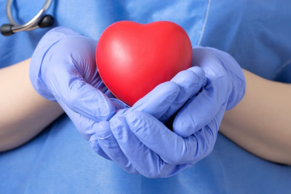 image of Doctor holding a heart