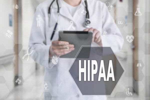 Image of HIPAA on the touch screen with medicine icons on the background blur Doctor in hospital.Innovation treatment, service, data analysis health. Medical Healthcare Concept Health Insurance Portability and Accountability Act, HIPAA